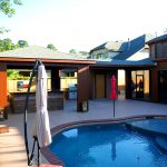 Custom Covered Outdoor Pool and Kitchen Patio Area