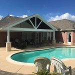 Large poolside timbertruss patio cover.