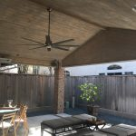 Custom installed ceiling fans and lights in cover patio.