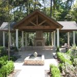 Beautiful custom timber truss covered patio and landscaping.