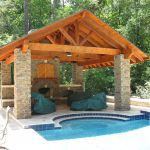 Poolside outdoor kitchen and custom patio cover.
